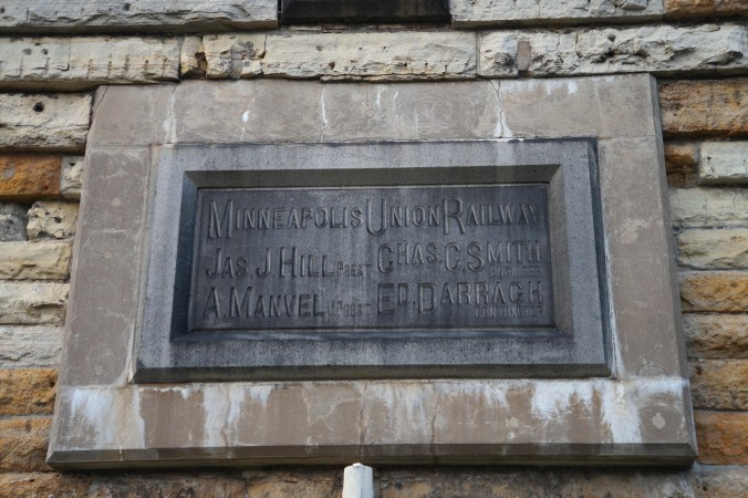 A plaque built into the side of the bridge